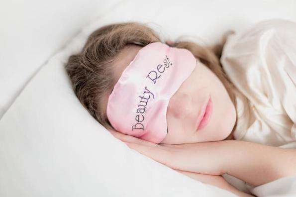 woman-in-beauty-rest-mask-in-pillow_925x
